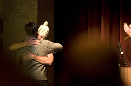 A Ben & Travis man-hug ensues as Red Gold recieves a standing ovation at it's premiere.